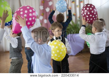Belarus, Gomel, on October 13, 2017. Kindergarten. Autumn festival.A little boy on holiday with balloons. Children's party