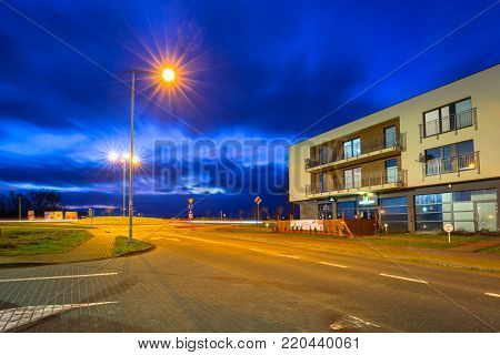 PRUSZCZ GDANSKI, POLAND - JANUARY 1, 2018: Architecture of residential apartments in Pruszcz Gdanski at dusk, Poland. Pruszcz Gdanski is growing industrial town neighbouring to Gdansk.