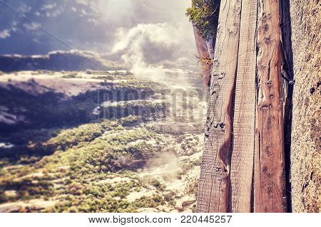 Plank Road at Mount Hua, worlds most dangerous hike, color toned picture, China.