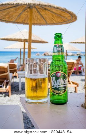 Mythos Hellenic Beer on a sunduck by the beach on Santorini Island, Greece. Photographed: July 4th, 2017.