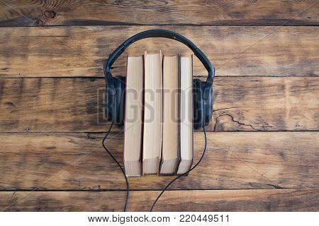 Headphones On The Pile Of Books On The Wooden Table. Audiobooks. Learning Through Audiobooks