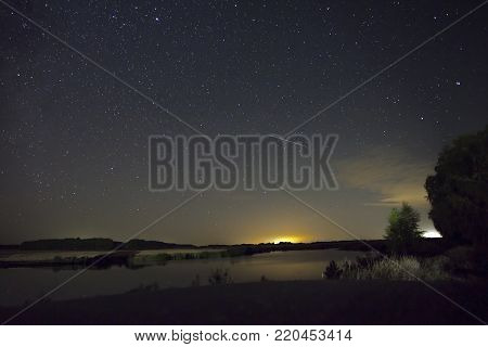 Beautiful night starry landscape, amazing landscape with starry sky. Scenic views of the starry sky. The starscape