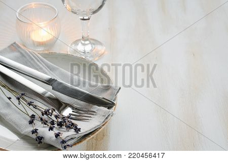 Festive table setting at vintage or provence style with candles and lavender. Concept Birthday, Valentine's, Mother's or Father's Day. Closeup. Copy space