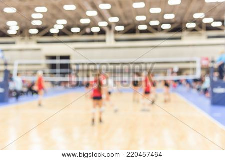 Blurred Teen Girls Playing Indoor Volleyball