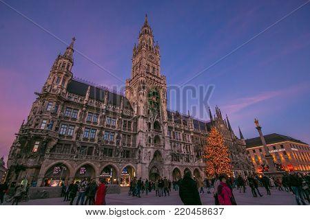 MUNICH, GERMANY - JANUARY 1, 2018: Beautiful view of Marienplatz with the Christmas tree in  Munich at sunset, Germany