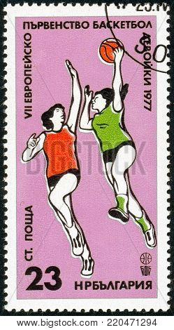 Ukraine - circa 2018: A postage stamp printed in Bulgaria shows drawing Game Scene. Series: European Basketball Championship of Junior Women. Circa 1977.