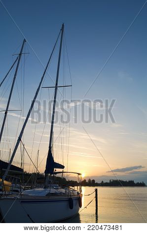 Sailboat on Lake Balaton at Dawn with Blue Sky