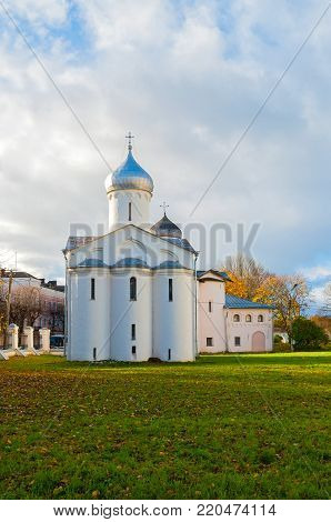Veliky Novgorod, Russia. Churches of St Procopius and Wives the Myrrh bearers at the Yaroslav's Courtyard. Architecture autumn landscape of Veliky Novgorod landmark