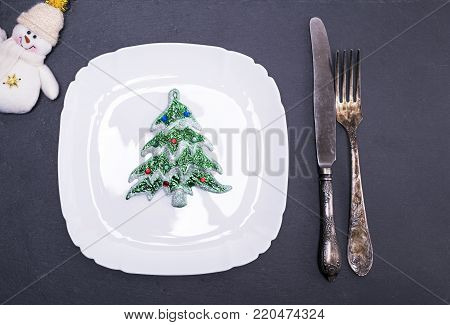 empty white square plate and iron vintage fork and knife
