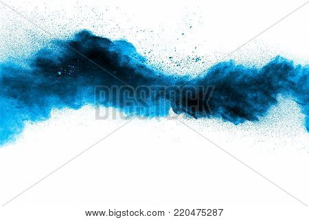 Abstract Blue Dust Explosion On  White Background. Abstract Blue Powder Splattered On White Backgrou