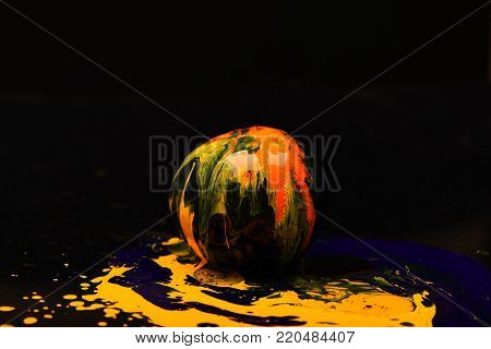 Paint Splashing On Orange Fruit. Nutrition And Food Art Concept.