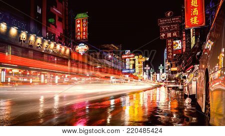 Bangkok, Thailand - DEC 26, 2017: Colorful of lights form cars and restaurant on Yaowarat road, Many street food and shopping market at night in China town.