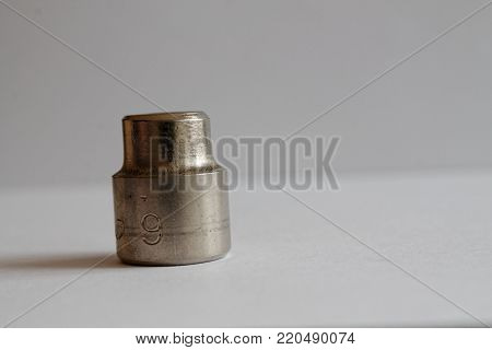 Torx Socket for spanner on wooden background, wrench sockets size is 13 poster