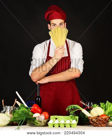 Food Preparation Concept. Chef With Smiling Face Holds Tomatoes