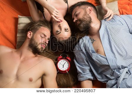 Swinger relations, relax, wake up. men and woman with long hair, lover. Family trust, polygamy, betrayal. people lovers sleep at alarm clock, time. Love triangle and romance, perfect morning. friends