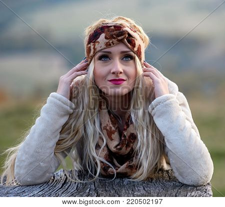 Beautiful young woman outdoor in autumn