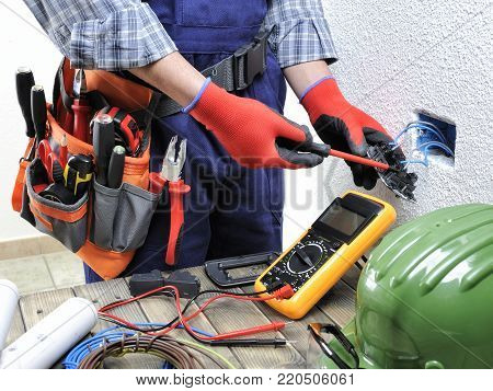 Young Electrician Technician Works In Compliance With Safety Standards In A Residential Electrical S