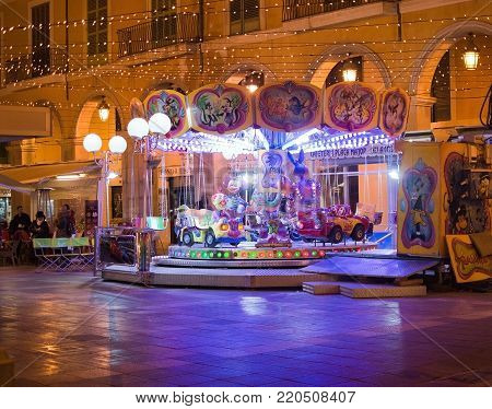 PALMA DE MALLORCA, BALEARIC ISLANDS, SPAIN - DECEMBER 5, 2017: Carousel at Plaza Mayor with evening Christmas light decorations on December 5, 2017 in Palma de Mallorca, Balearic islands, Spain.
