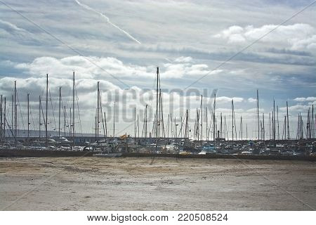 PLAYA DE PALMA, MALLORCA, SPAIN - DECEMBER 14, 2017: Masts in the marina on an overcast day on December 14, 2017 in Mallorca, Balearic islands, Spain