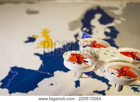 Mini drone flying over a EU map. The EU is working on a regulation to safely integrate remotely piloted drones into the European airspace.The regulation is expected to be completed in spring 2018