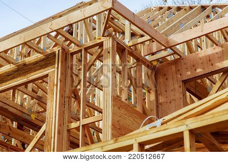 Close-up of gables roof on stick built home under construction New build roof with wooden truss, post and beam framework. Timber frame house, real estate.