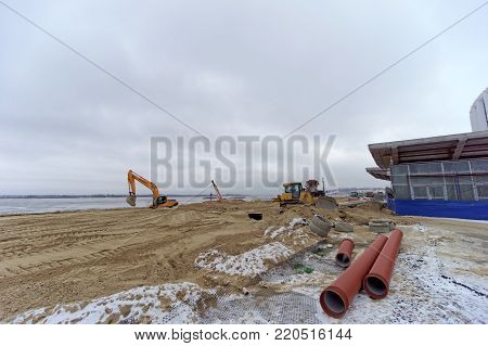 Nizhny Novgorod, Russia. - December 1.2017. Accomplishment of territory near the football stadium in Nizhny Novgorod to the FIFA World Cup 2018. The photo is taken on a wide-angle lens.