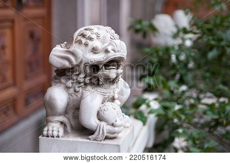 This lion statue is the guardian of palace and this mythical animal is regarded to protect city and palace against fire in East Asia.