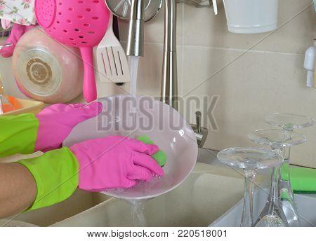Washing A Pink Plate