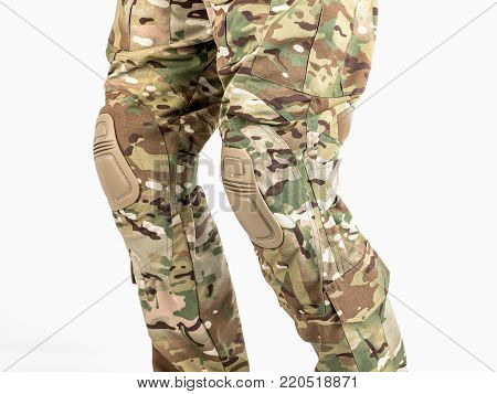 Chest pants for outdated activities. Camouflage pants. Detail of the knee with the wheelbarrow.