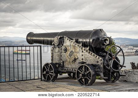 Old vintage cannon protecting sea bay on rock of Gibraltar