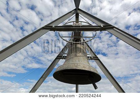 KRONPLATZ, ITALY - SEPTEMBER 2017 : Concordia 2000, peace bronze bell on mountain Bruneck in Kronplatz, South Tyrol, Italy on September 23, 2017. Cast on Kronplatz ski center'??s 25th anniversary