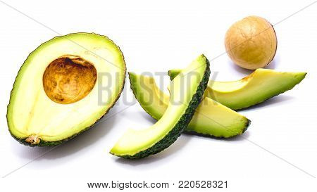 Avocado (Persea americana, alligator pear) slices and one half with a stone isolated on white background