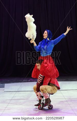 ST. PETERSBURG, RUSSIA - DECEMBER 28, 2017: Victoria Akimova (top) as Gerda and Sergey Akimov as Kai with trained dogs in the circus show Snow Queen by Great Moscow circus