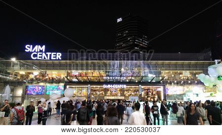 BANGKOK, THAILAND- DEC 28, 2017: Siam interchange station near Siam Paragon shopping mall in twilight time.This is one of the biggest shopping center in Asia. It includes a wide range of specialty stores and restaurants.