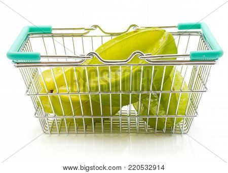 Fresh carambola in a shopping basket isolated on white background
