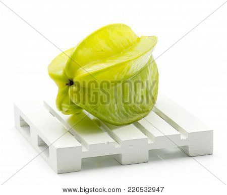 One carambola on a pallet isolated on white background