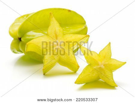 Sliced carambola isolated on white background two star slices and one whole