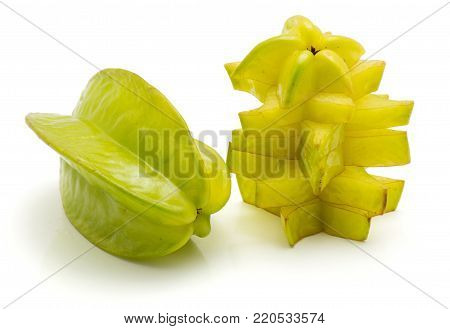 Sliced carambola star slices and one whole isolated on white background
