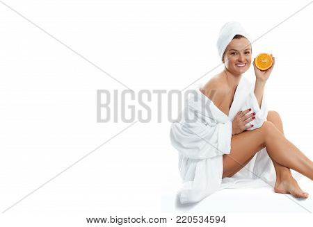 Beautiful woman in bathrobe. Beauty, cosmetics, bodycare and spa concept