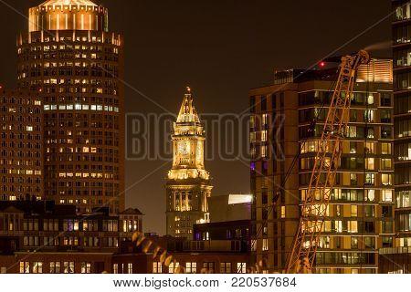 Custom House Tower Among Boston Skyline shines at night