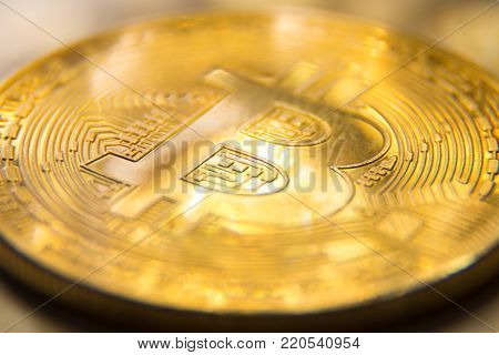 Macro photography of golden bitcoin with light spots. Close up.