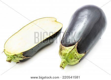 One whole and one half eggplant (aubergine), longitudinal section, isolated on white background