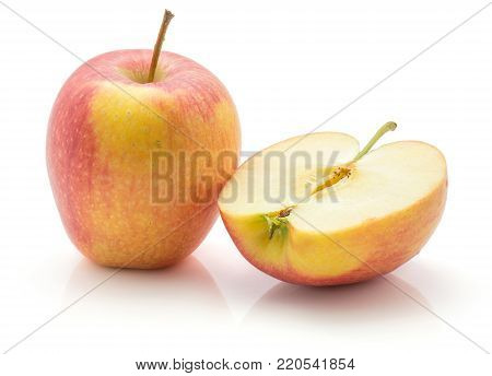 Apple (Evelina variety) isolated on white background one whole and one cross section half