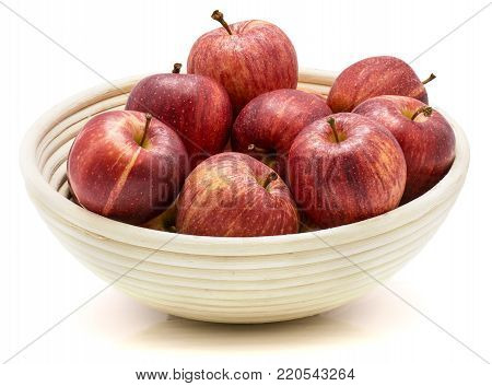 Gala apples in rattan bowl isolated on white background