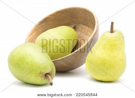 Three green pears in a wooden bowl isolated on white background poster