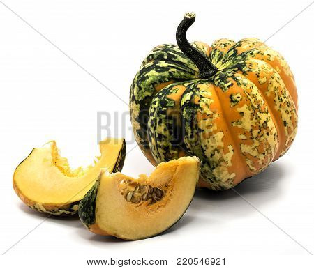 One whole spotty green yellow pumpkin, two slices with seeds isolated on white background