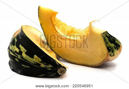 Two spotty green yellow pumpkin slices with seeds isolated on white background