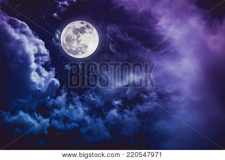 Beautiful vivid cloudscape with many stars. Night sky with bright full moon and cloudy, serenity nature background. Outdoor at nighttime with moonlight