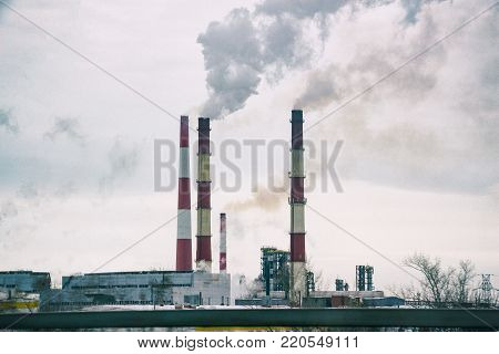 Smoking chimneys of the plant. Fuming chimney of a factory