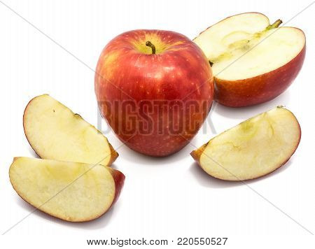 Kanzi apples composition, one whole, one half, three slices, isolated on white background